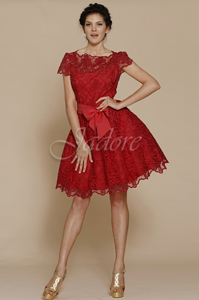 This fun party A Line dress will raise everyones spirits at any social occasion. This dress exudes cheeky innocence with a high lace overlay across the front for the dress, Jadore then embraces a racy edge through the back with a steep v back. It is vibrant and available in this seasons colours.